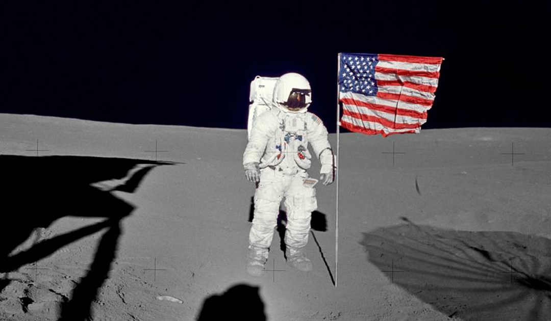 Navy Captain Edgar Mitchell deploys flag during Apollo 14 Mission